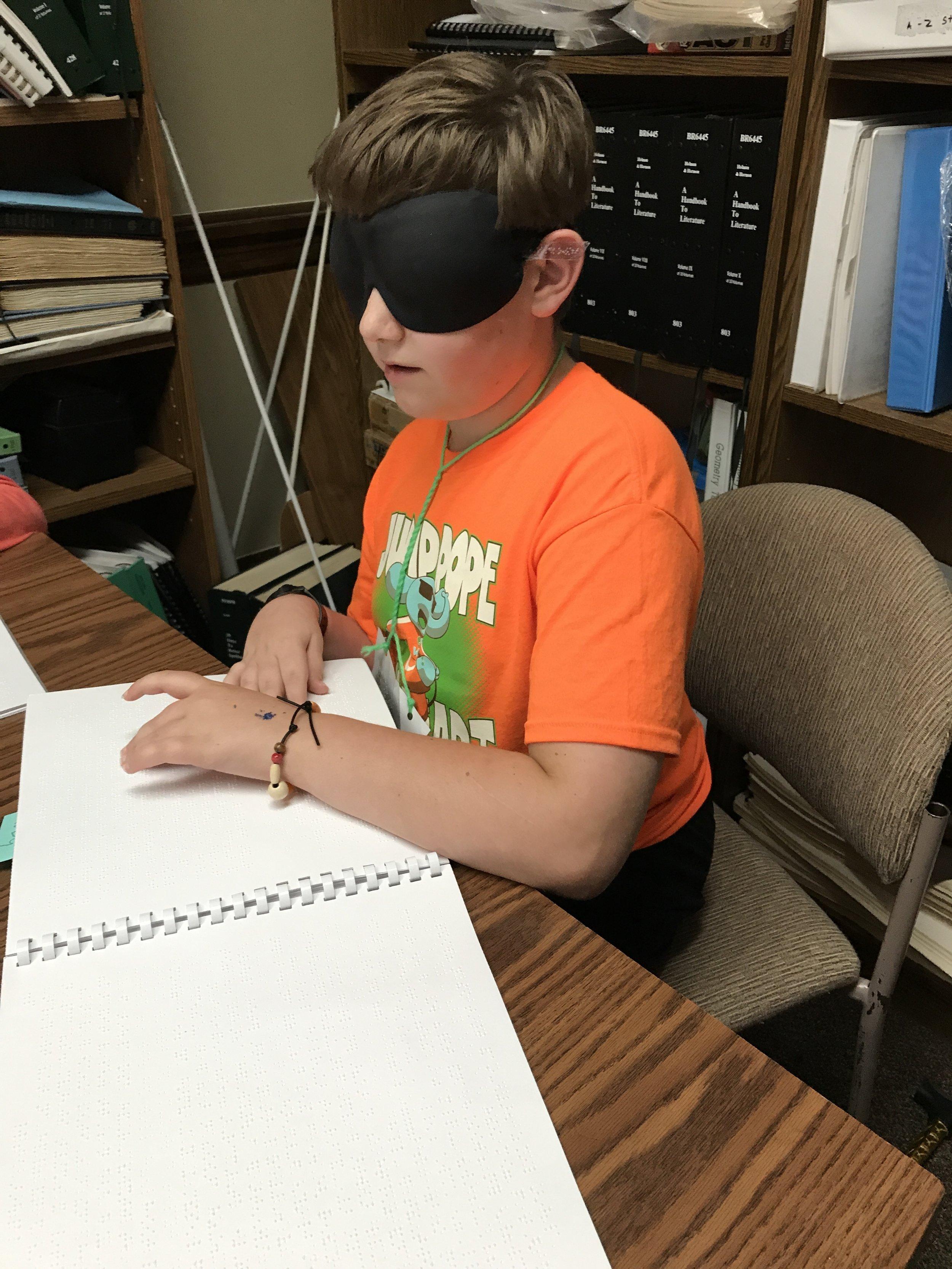Nicholas reading about Louis Braille