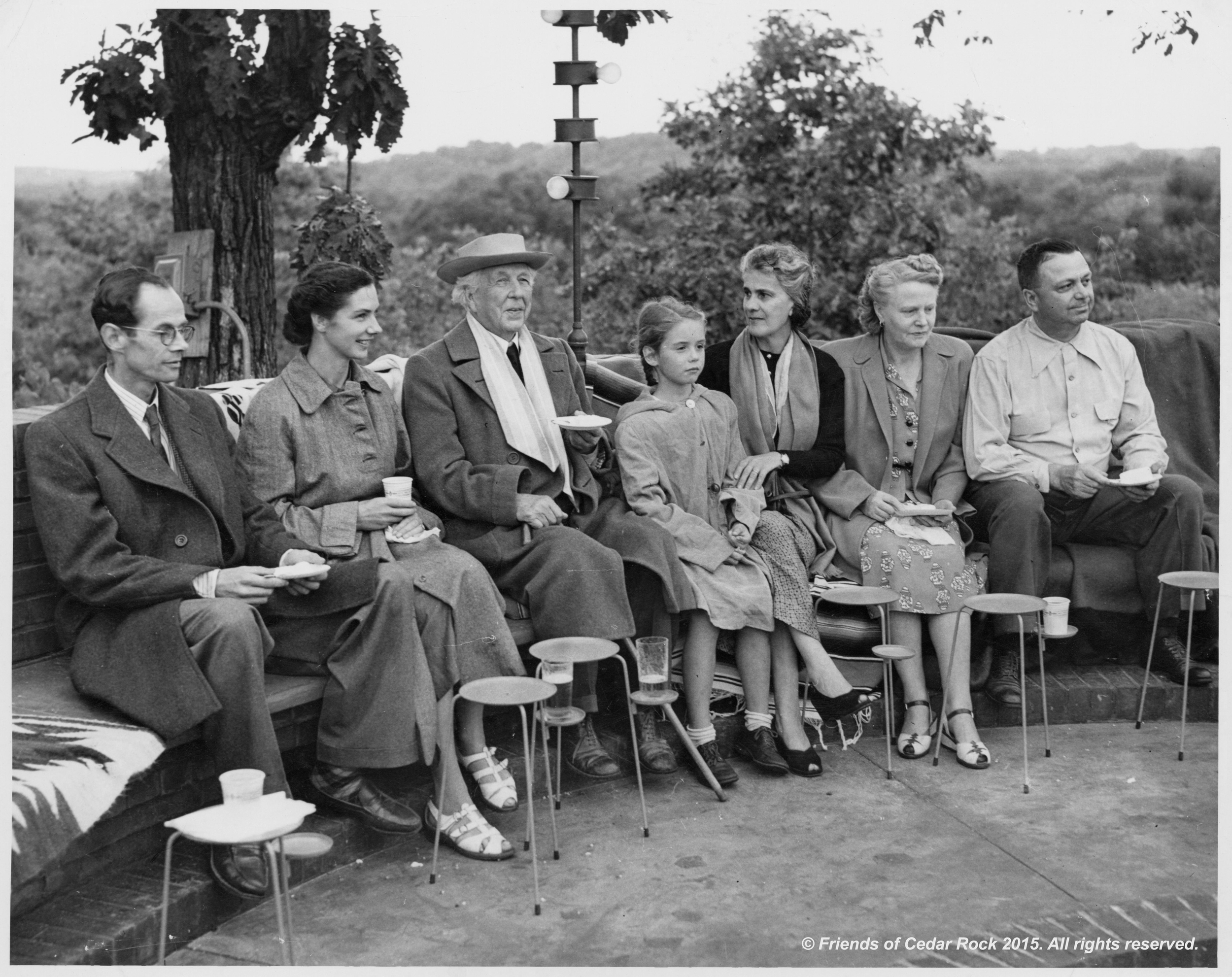 Lord and Lady Pentland , Frank Lloyd Wright, Olgivana Wright, Agnes and Lowell Walter celebrate the completion of the home around the council fire at Cedar Rock.