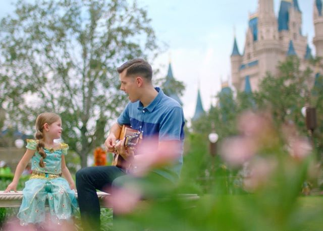 """A whole new wooooorld..."" 🎶. @clairecrosby and @davecrosby singing by the #MagicKingdom Castle!. Watch it! ⬇️. . . . Check it out in the link on the bio! @onmuute"