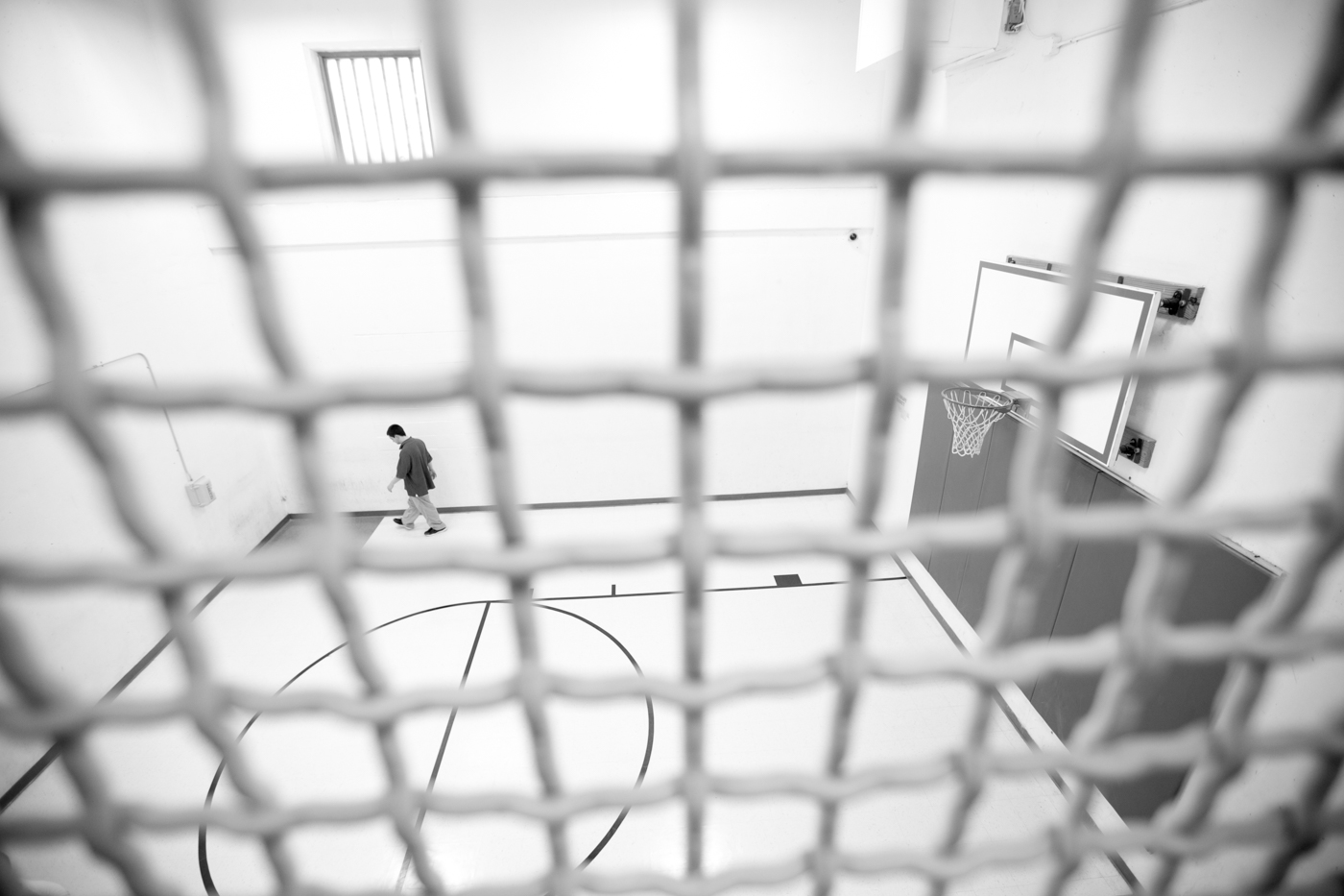 CARA participant Joe Santerre paces the indoor recreation facility at the Kennebec County Correctional Facility. Santerre's original sentence extended past the eix week length of the CARA program and he was unsure whether the sheriff would release him upon his completion. The CARA program relies on segregating participants from the general population in order to create an environment where the core causes of addiction and criminal behavior can be addressed.