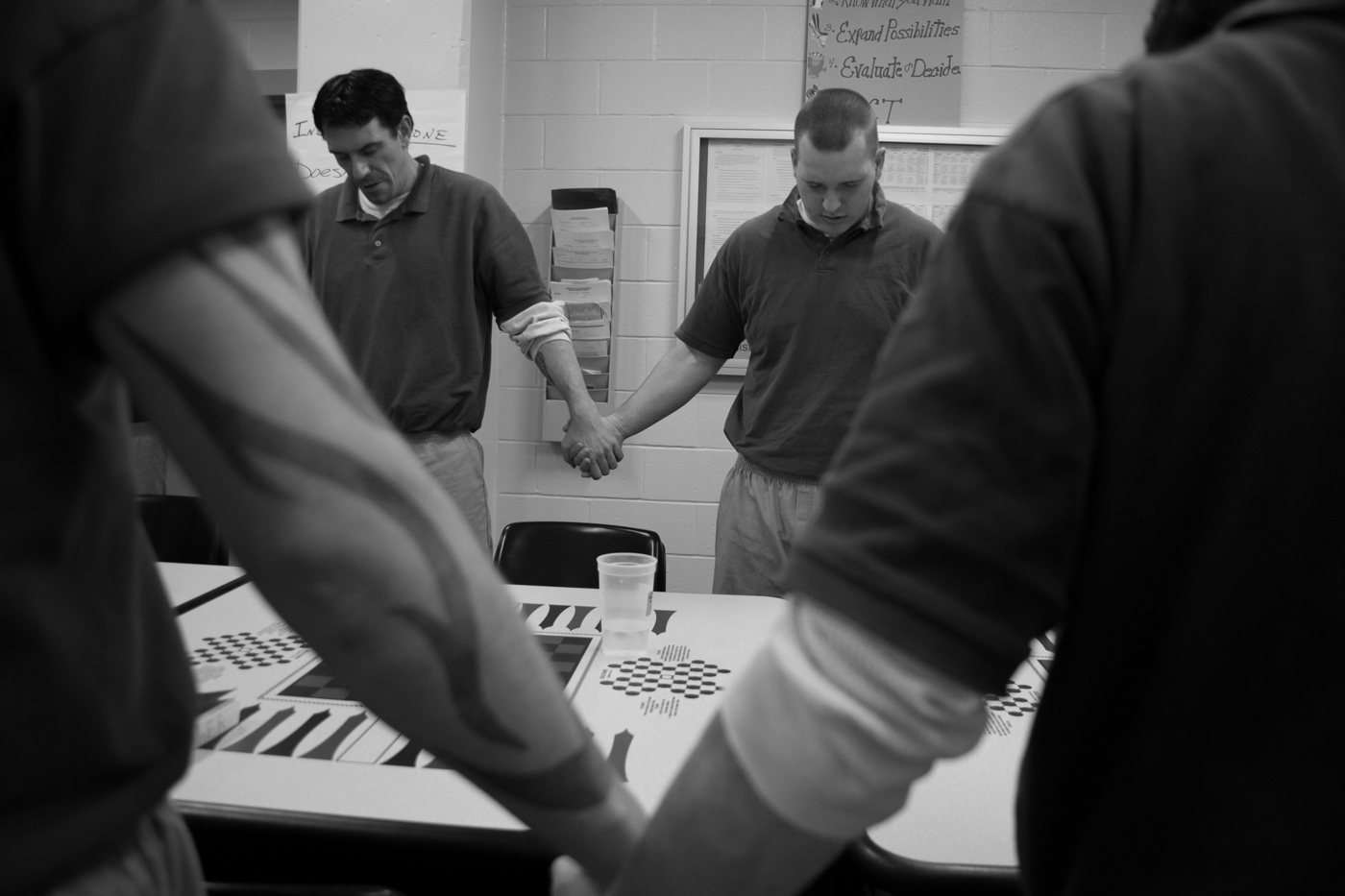 "The CARA group prays together before starting their day. The CARA program is structured around responsibility and support for each individual towards the group and the group toward the individual ""In here we are not inmates. We are participants,"" said Dakota Sanford. ""We are nine guys. We are a unit."""