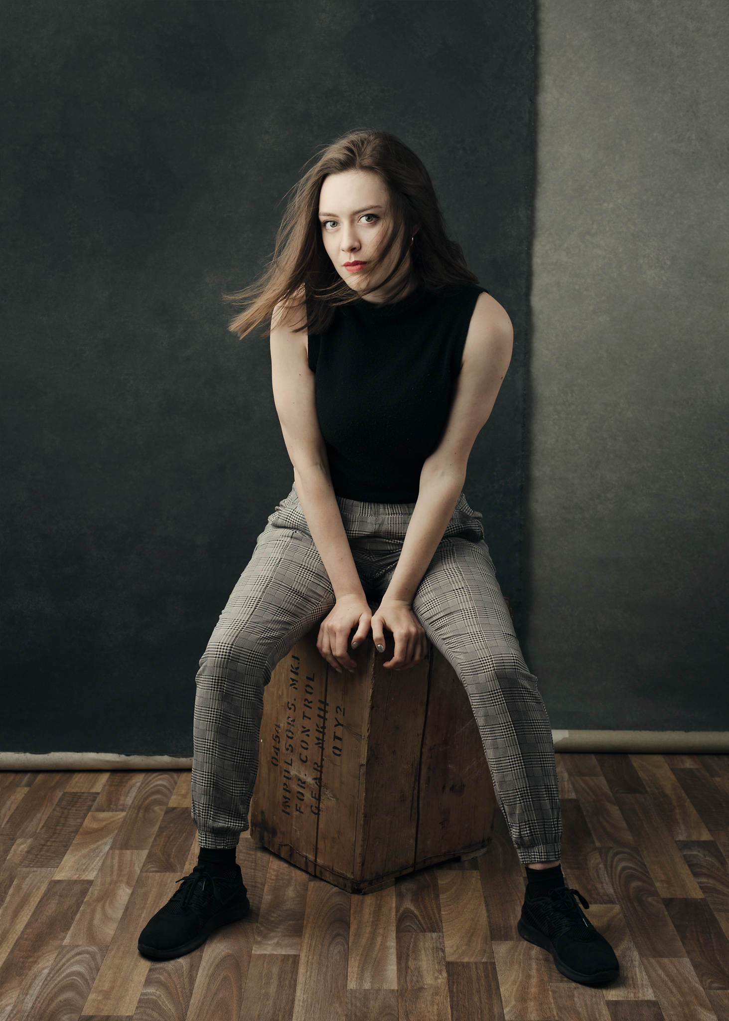 Rosie sitting on an apple box at our Bath photography studio