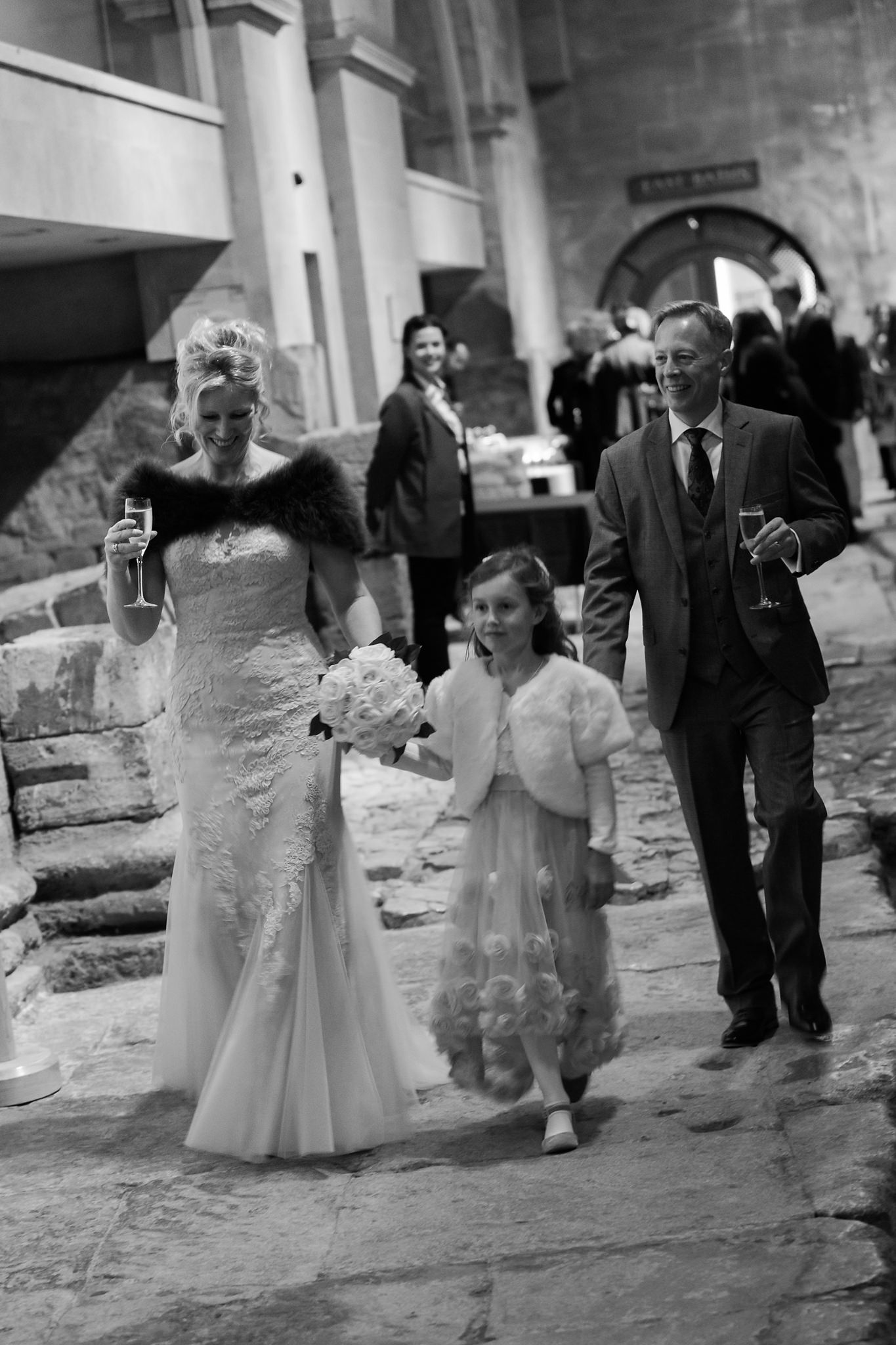 Bride and groom with their young bridesmaid