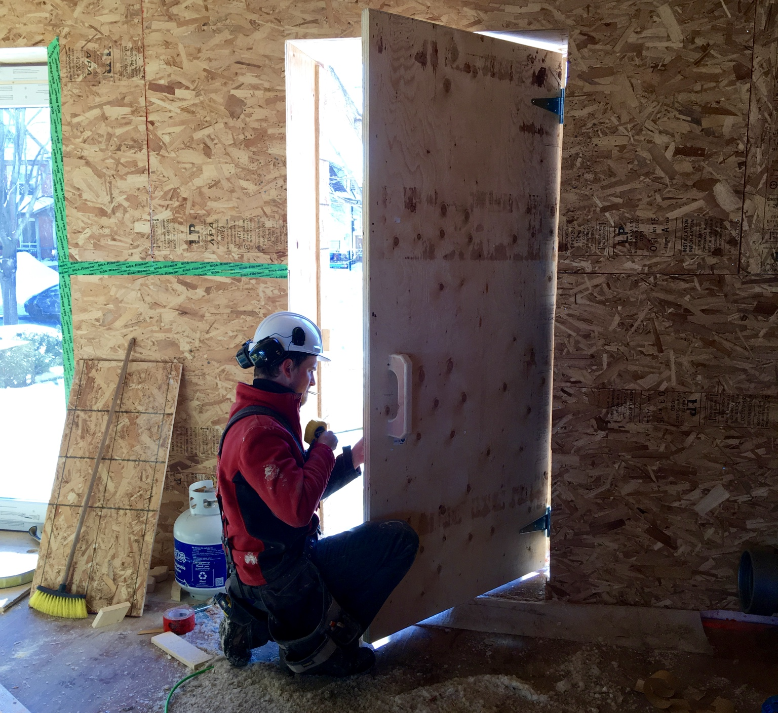 Justin working on our temporary door — check out the routered handle!