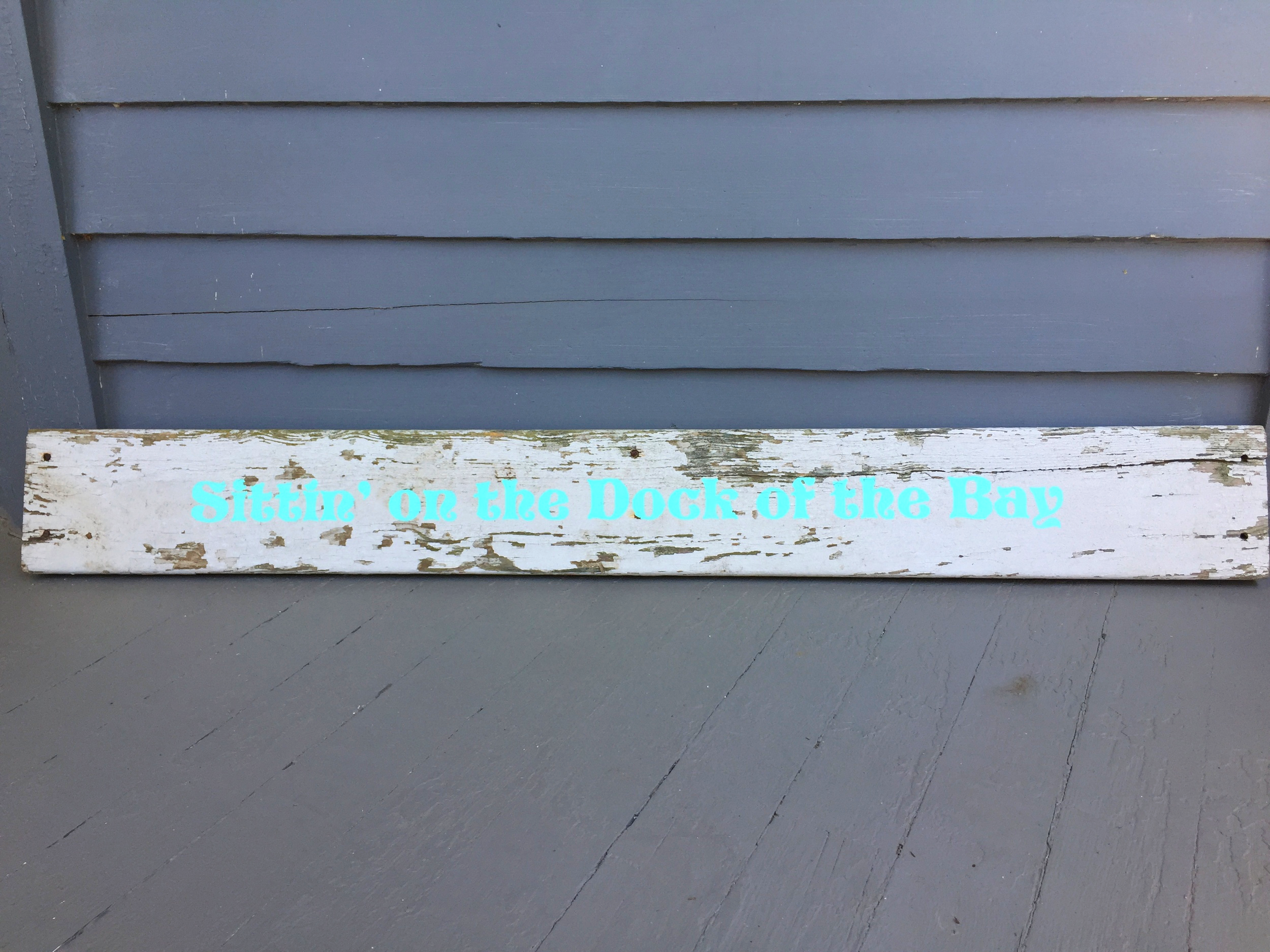 coastal lyrics on a piece of old dock plank...