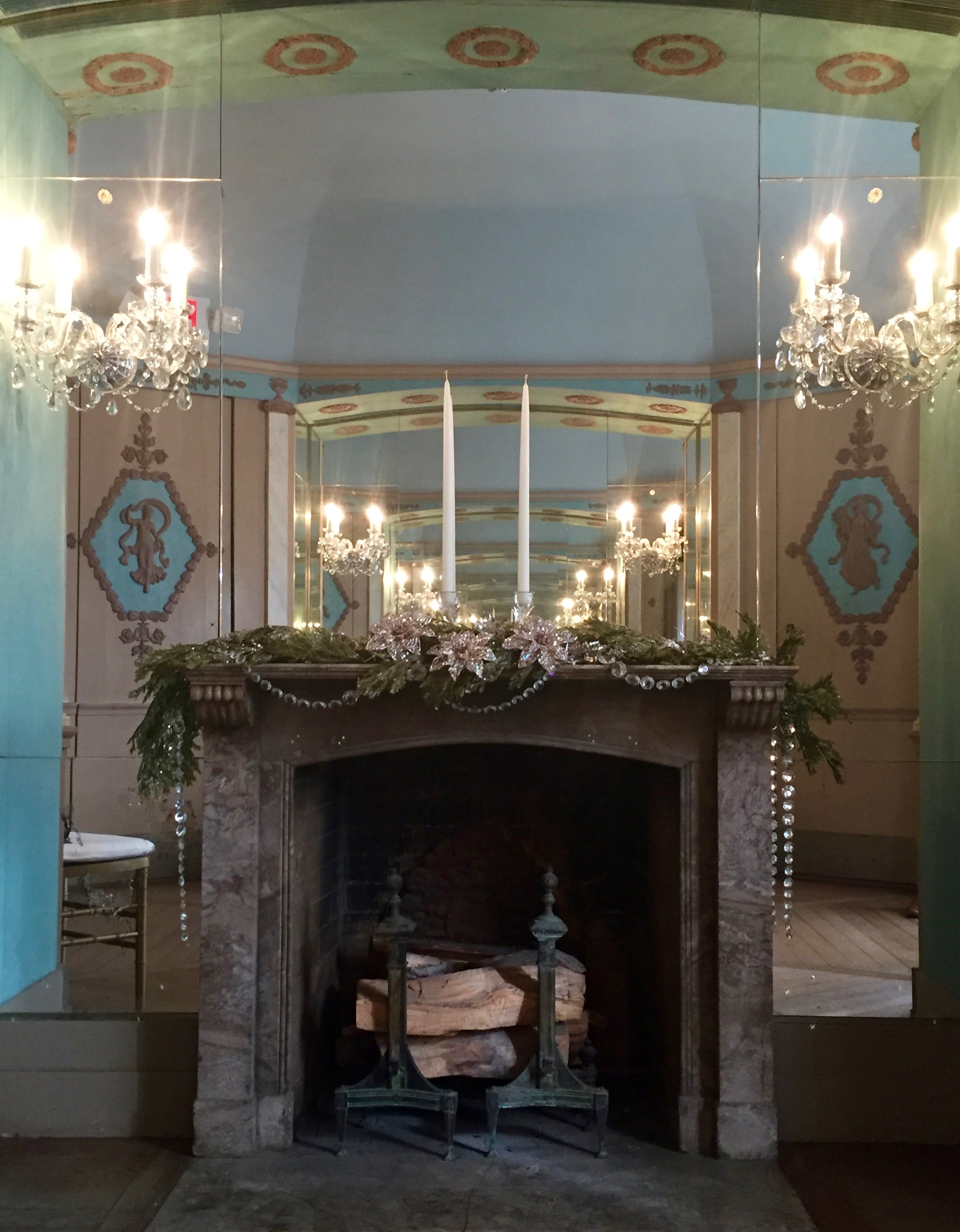 The fireplace in the Mrs. Vanderbilt's dressing room was topped with a simple green garland and draped in crystals to compliment the chandeliers in the room and on the necklace on the Christmas Dress.