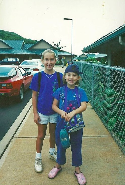 Jamie rocks overalls with her embarrassed big sister, Jessica,on the first day of 1st grade.