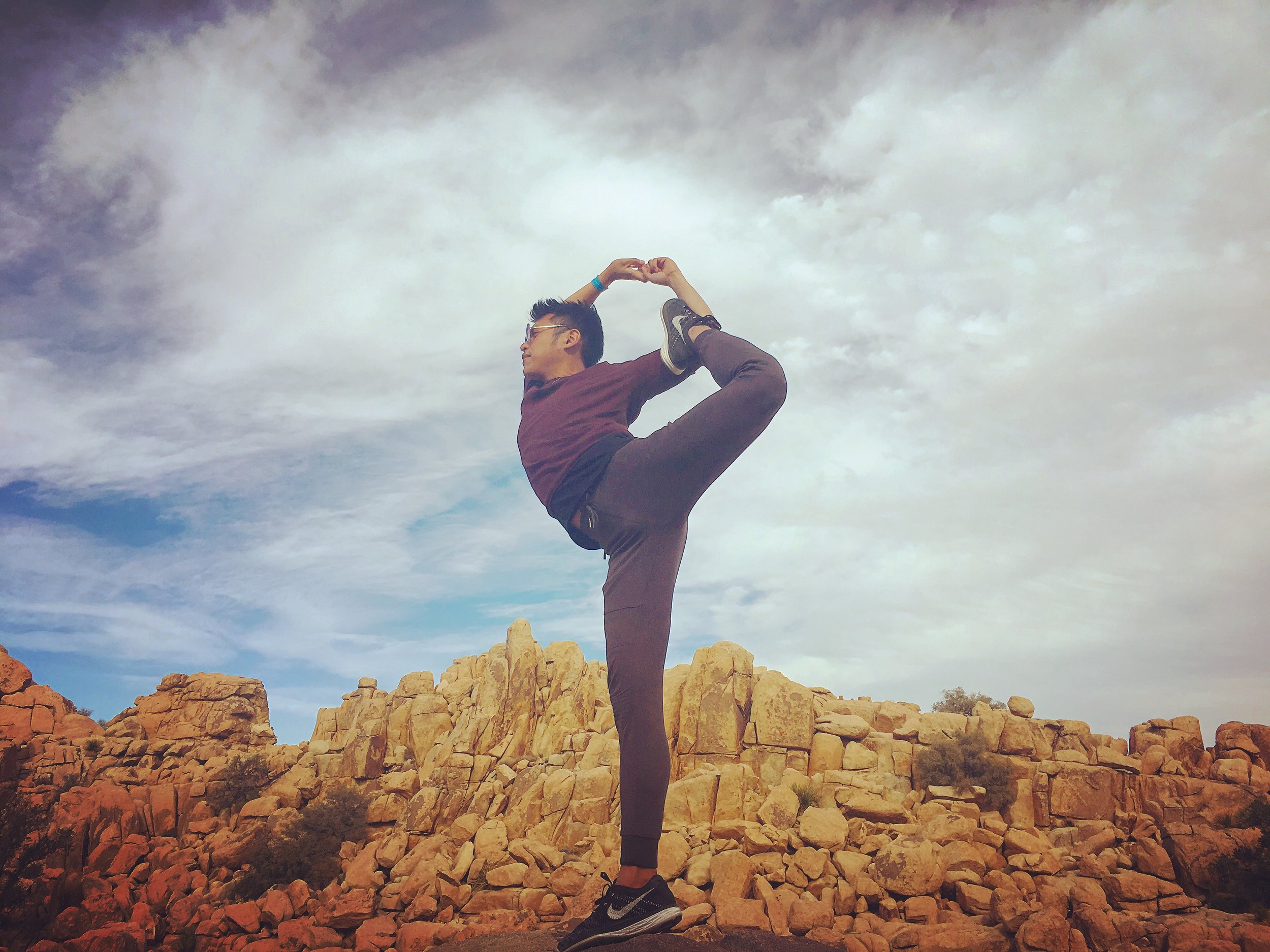 Anthony practicing Natarajasana (Lord of the Dance pose with bind) at Joshua Tree National Park