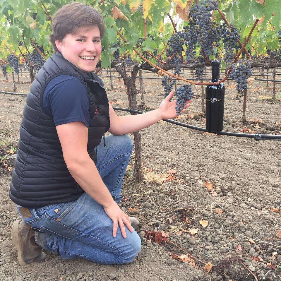 Assistant Winemaker Evyn Cameron poses next to healthy 2017 Crocker & Starr Cabernet Sauvignon photo courtesy Crocker & Starr winery