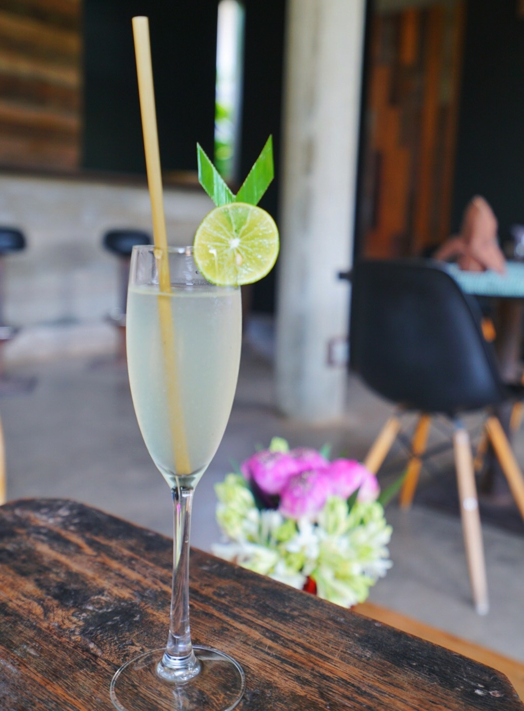 welcome drink sala lodge siem reap cambodia champagne glass bamboo straw.JPG