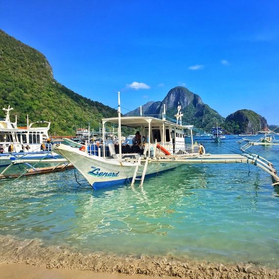 beach boats el nido palawan philippines
