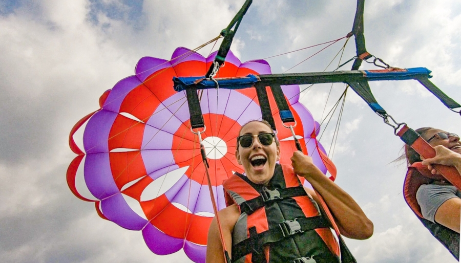 Things to do in Lake George, New York, include parasailing and ziplining