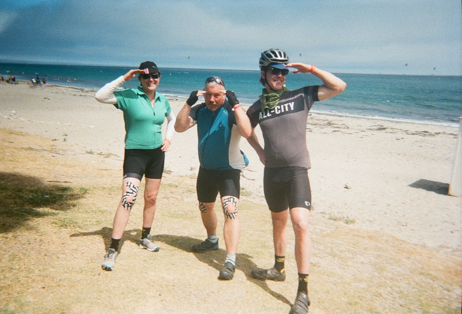 Nearing the finish line in Santa Barbara with taped-up knees to ease our aches and pains