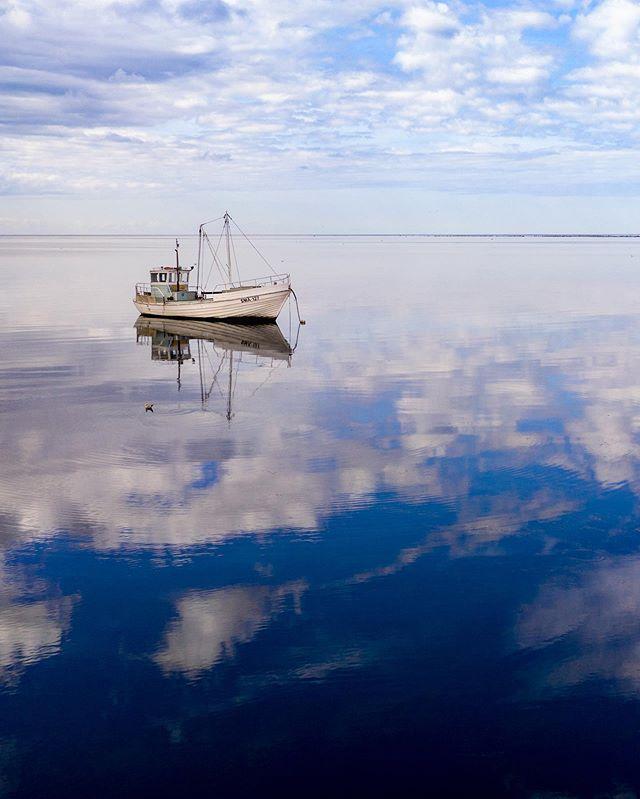 Fishing boat. #saaremaa #estonia #drone #mavic2pro #mavic #mavicpro2 #mavic2 #mavichasselblad #fishingboat #sea #reflection