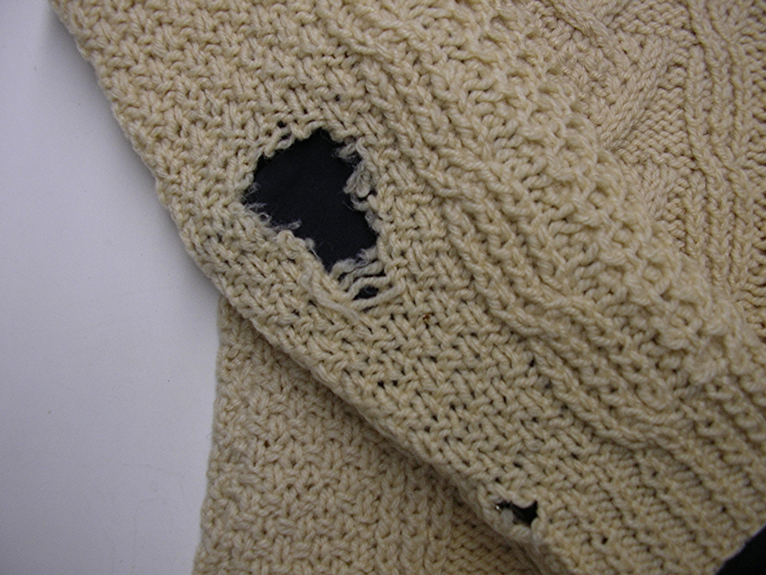 After finding a shade of wool to match, the broken stitches are gathered and knitting with needles is done.