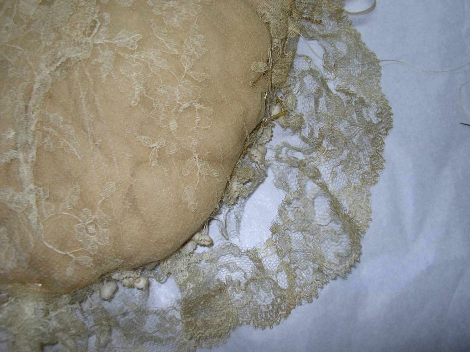 While it remains fragile... with some gently applied stitches, (and the bearer wearing gloves!)...