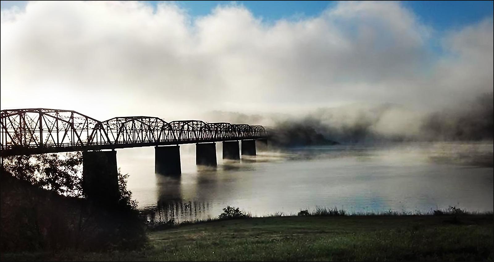 Mist rises from Bull Shoals Lake at Theodosia Bridge, viewed from Theodosia Marina-Resort.