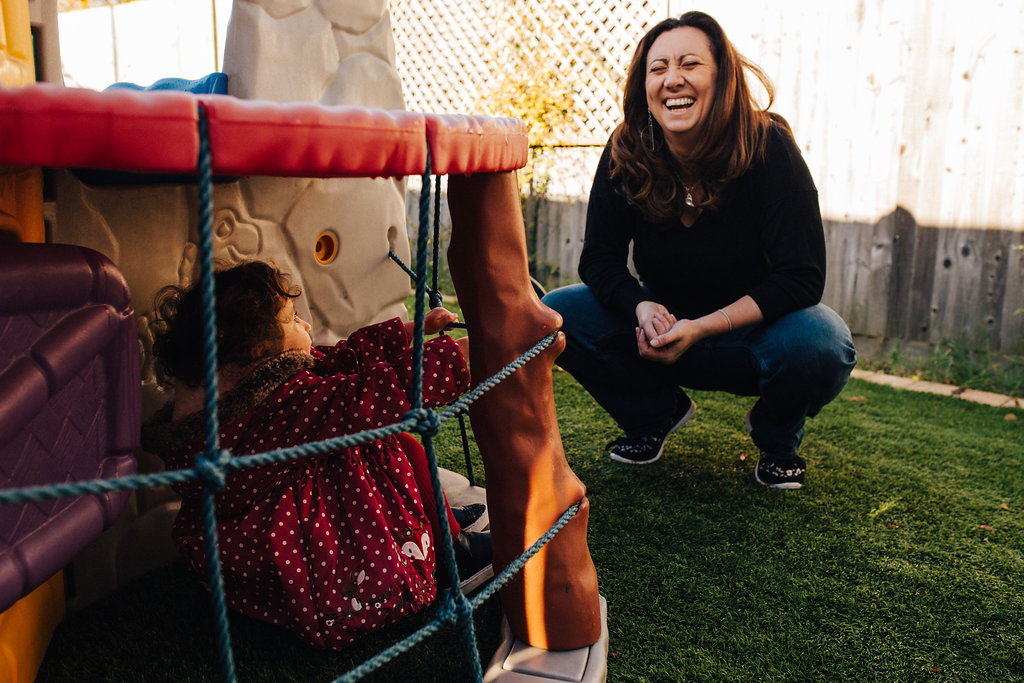 Mum Alyssa laughing with daughter