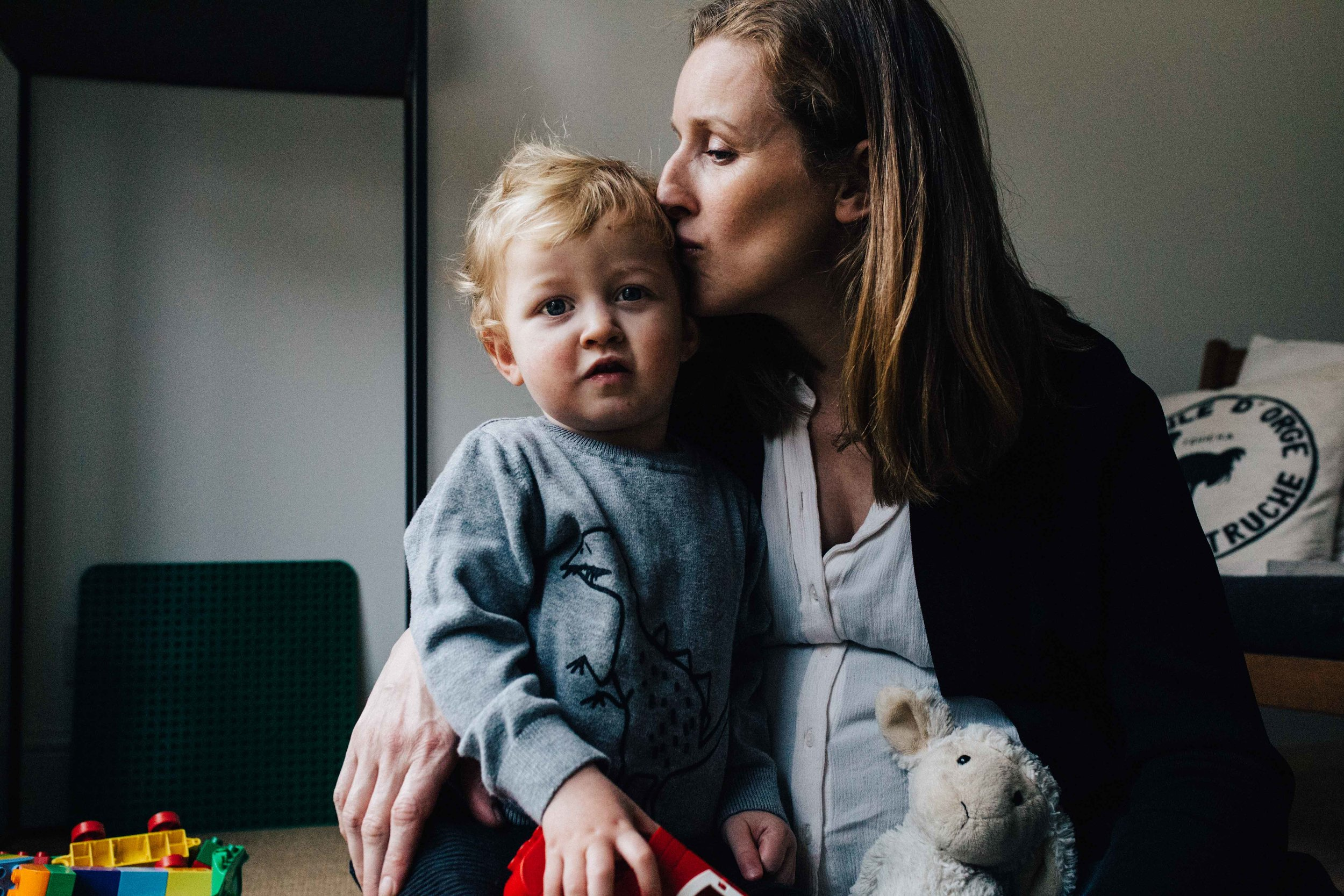 London family photographer - mother and son hugging during family photoshoot