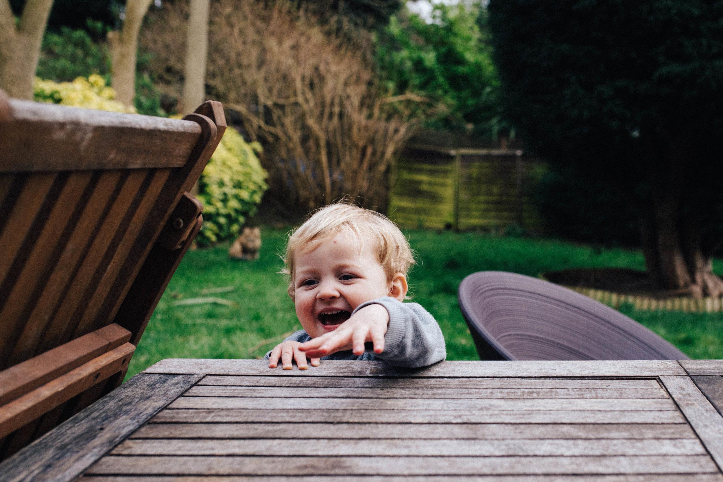 Children photography: boy smiling in the garden