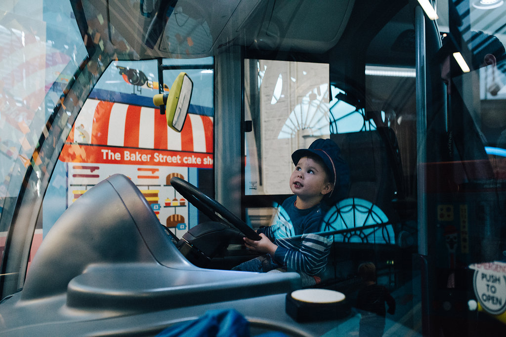 Child driving a bus at Museum of Transport in London