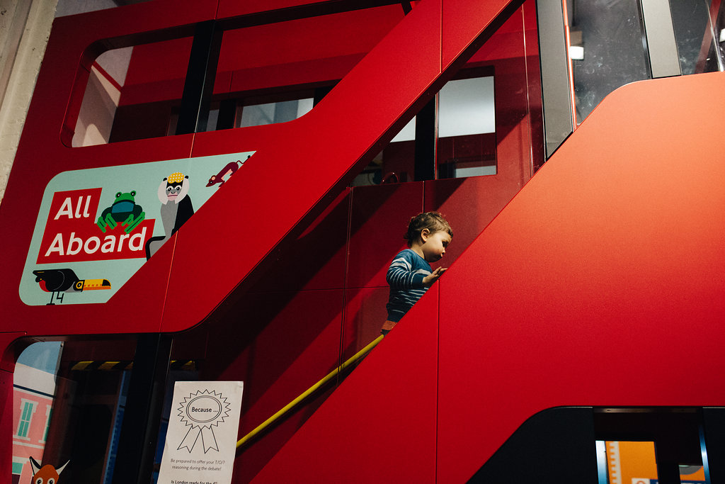 Little boy going up the play area at London's Transport Museum