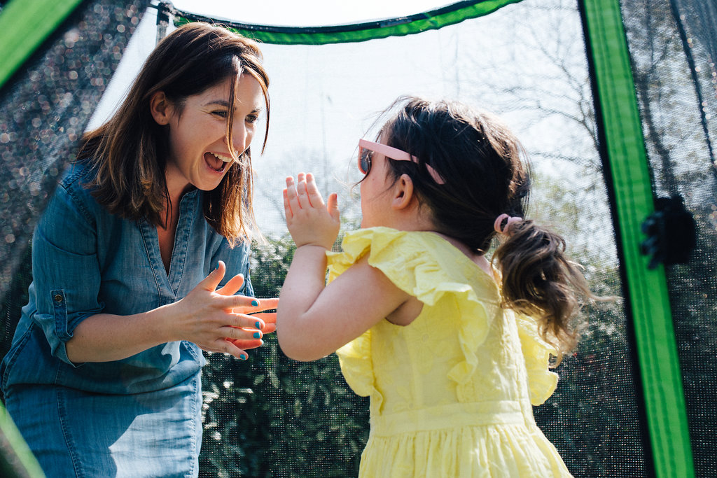 Mum and daughter playing on trampoline during family photoshoot in London and Beckenham, Kent