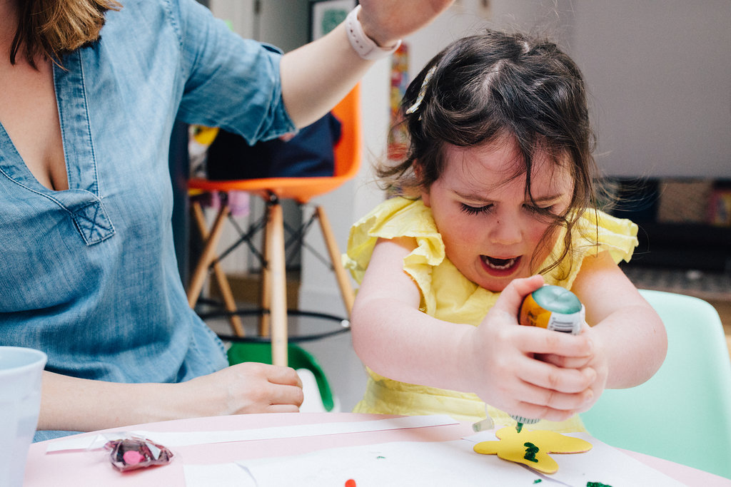 Little girl doing crafts during at home family photo shoot