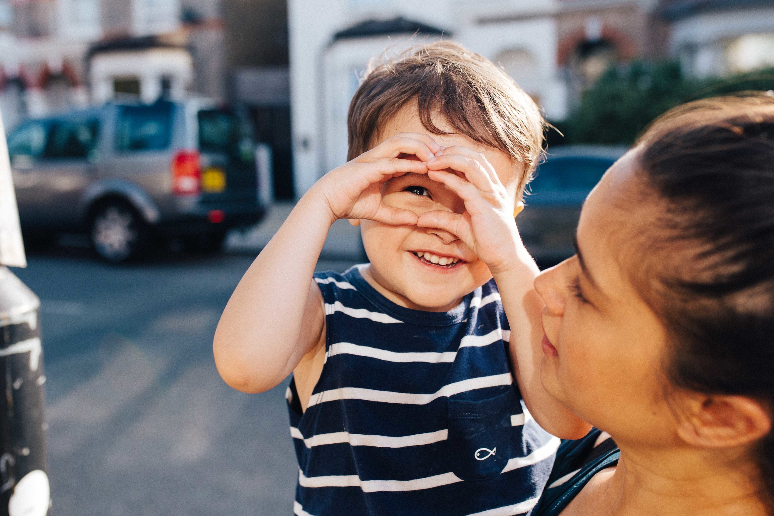 Dulwich family photographer - Boy and mother in the streets of East Dulwich during family photoshoot