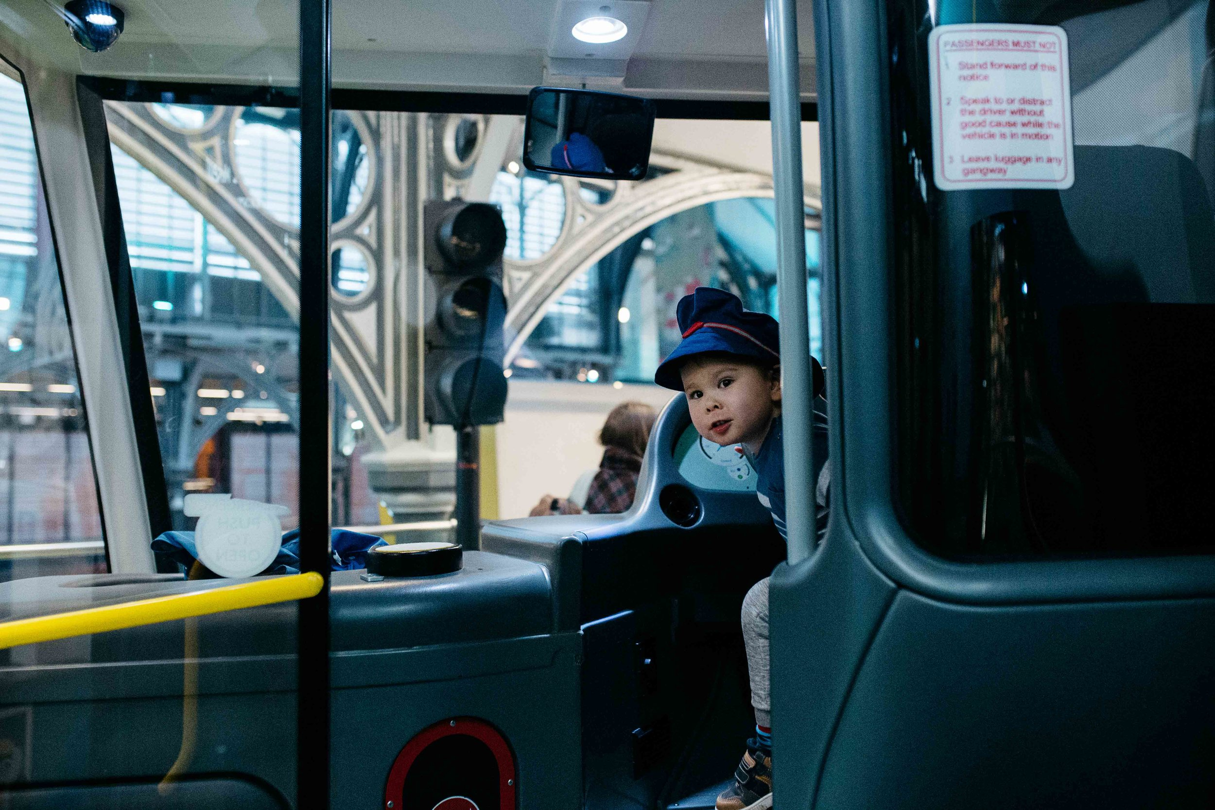 Little boy in a bus at the Museum of Transport in London during children photography session