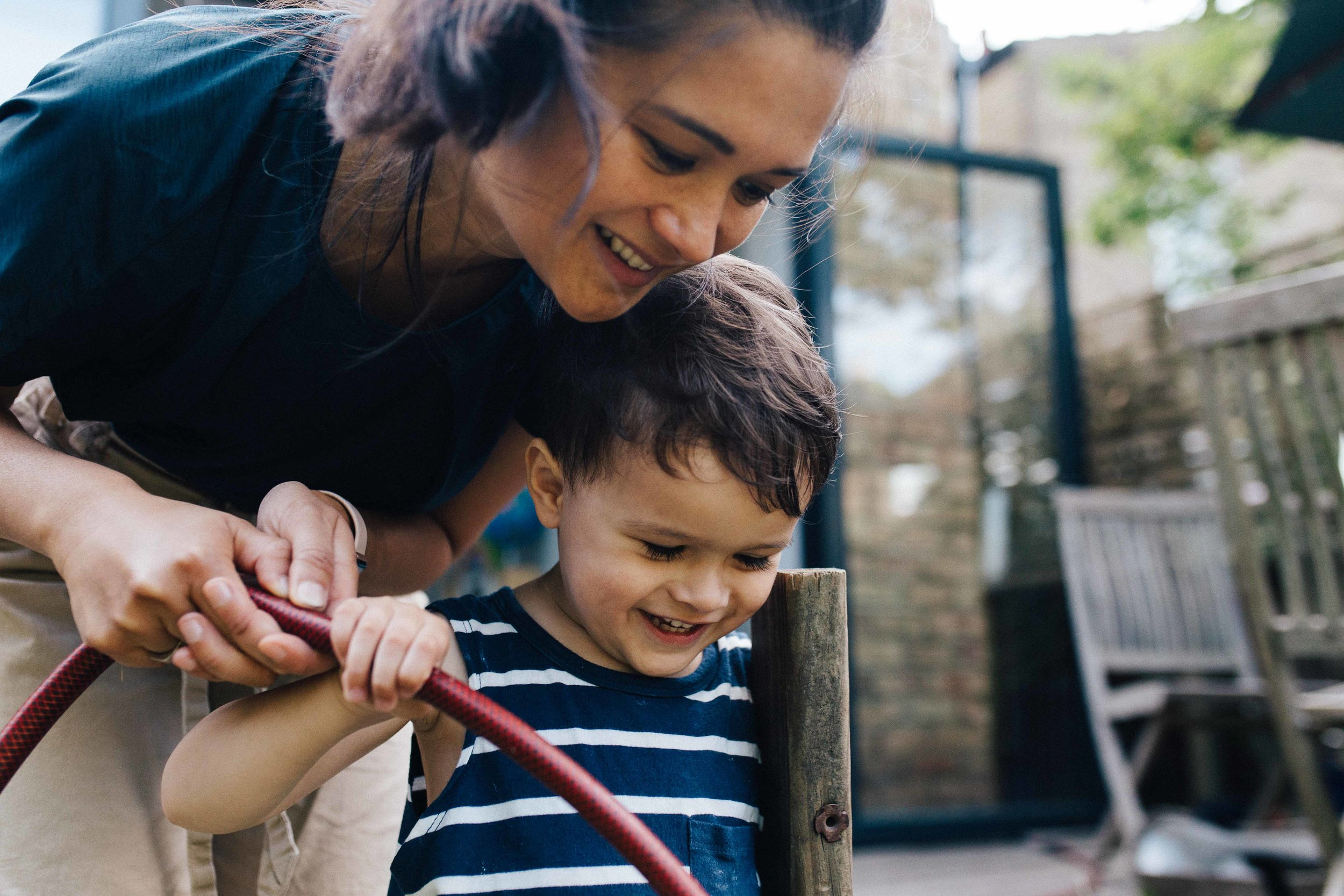 Family photographer in South London - mother and son in their East Dulwich garden
