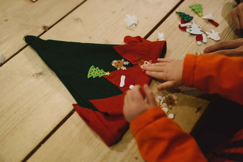 Child decorating elf hat