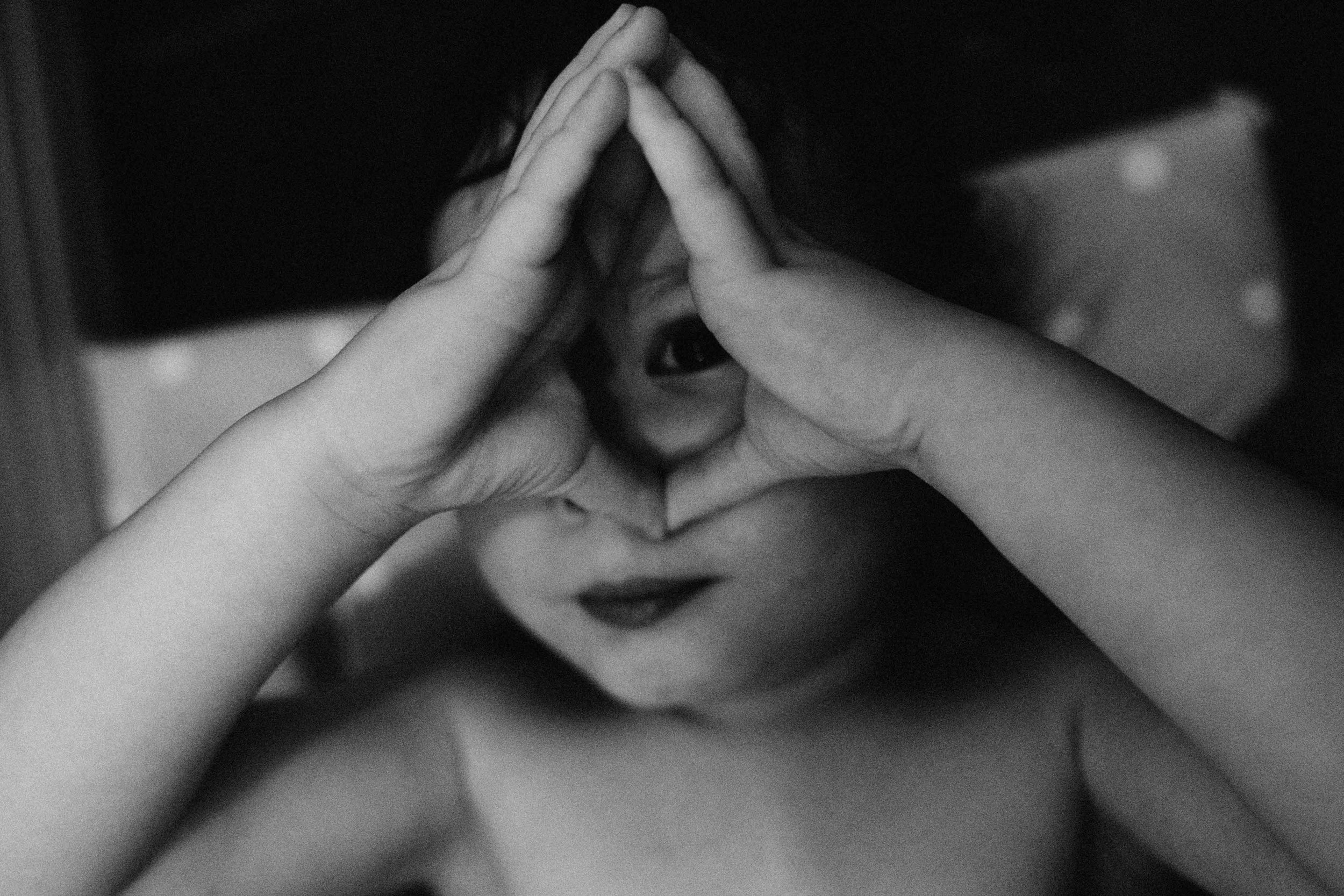 Boy looking through his hands