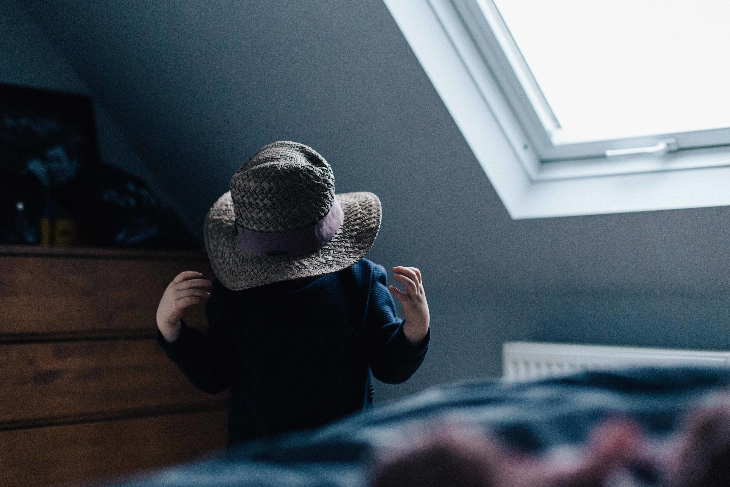 Boy with head in hat