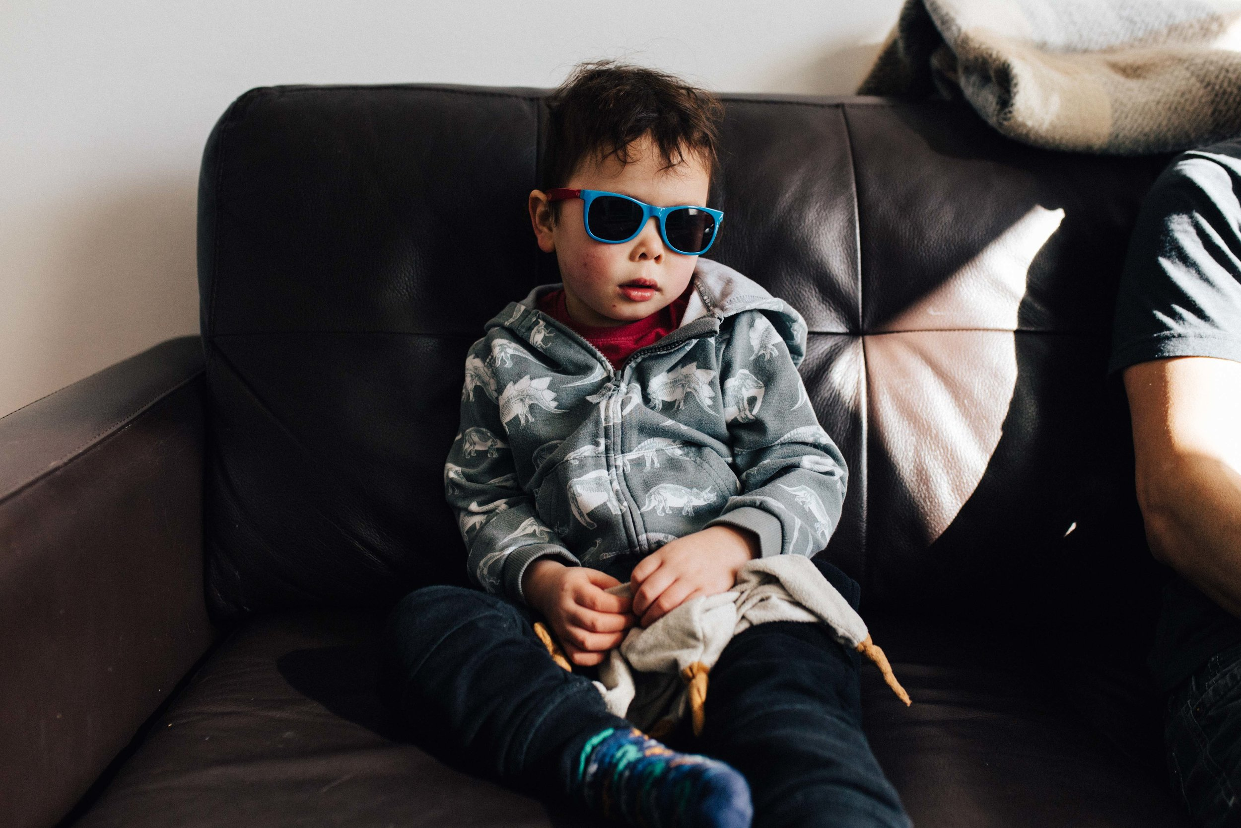 Boy on sofa with sunglasses