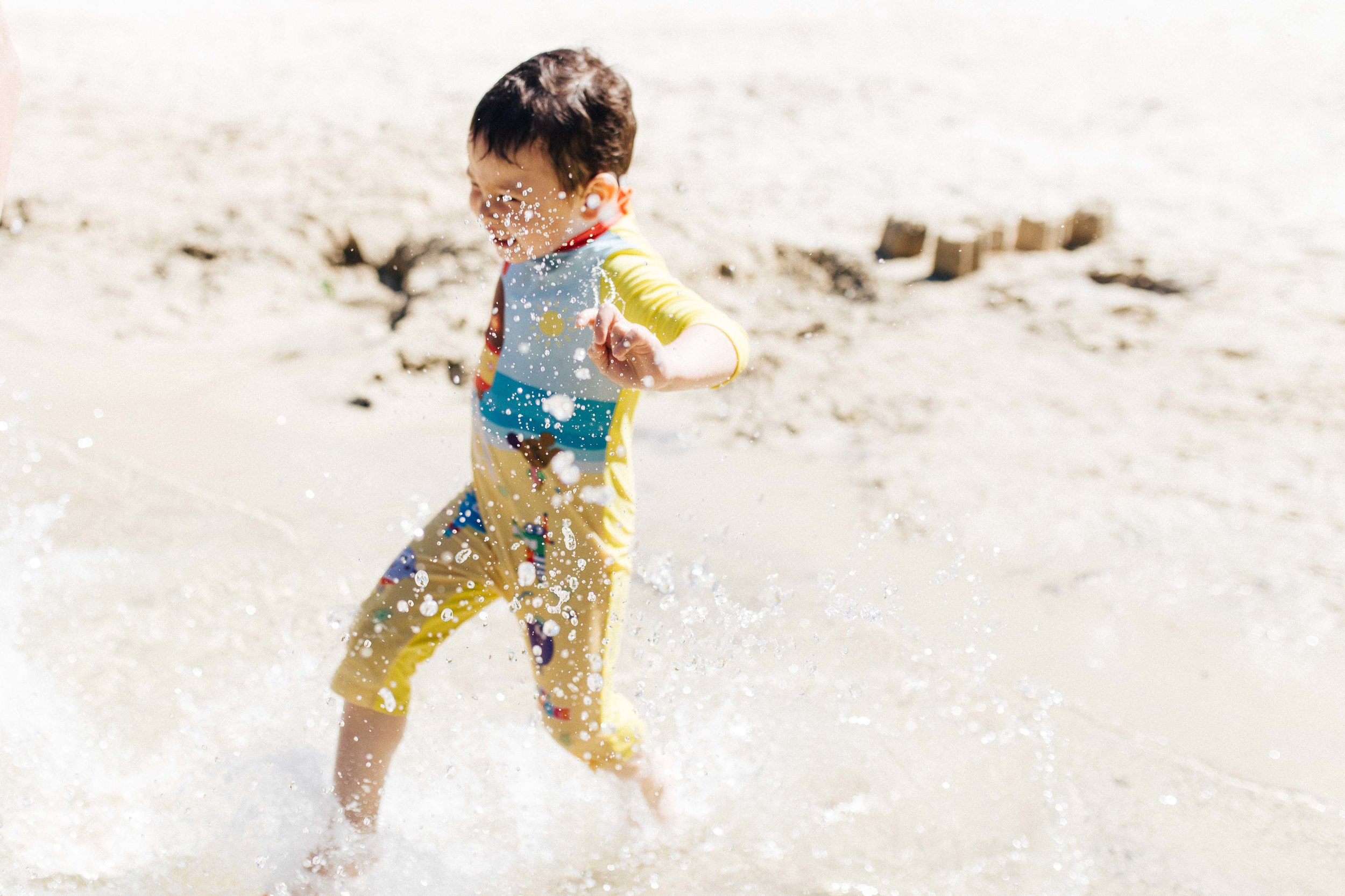 Boy running in the water