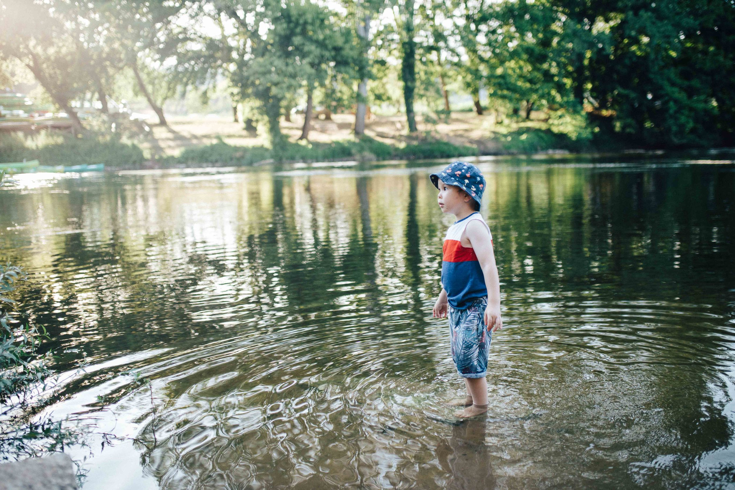 Boy standing in a river