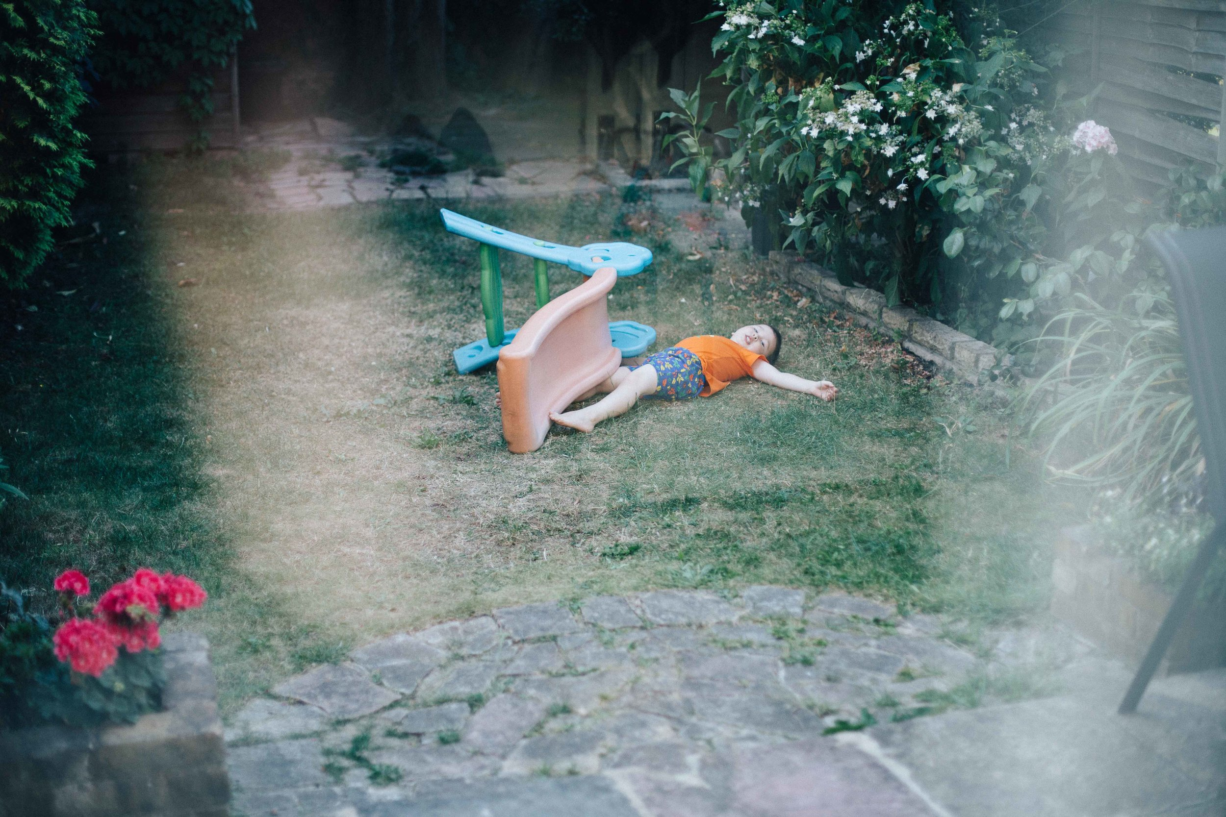 Boy on the floor next to slide