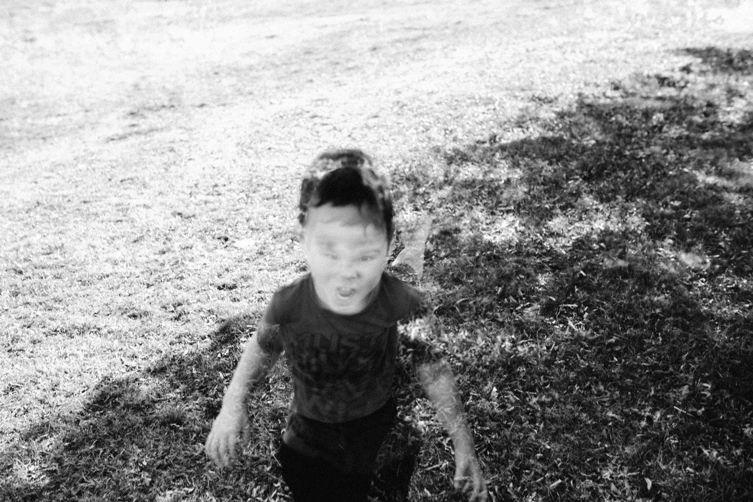Double exposure of boy in black and white
