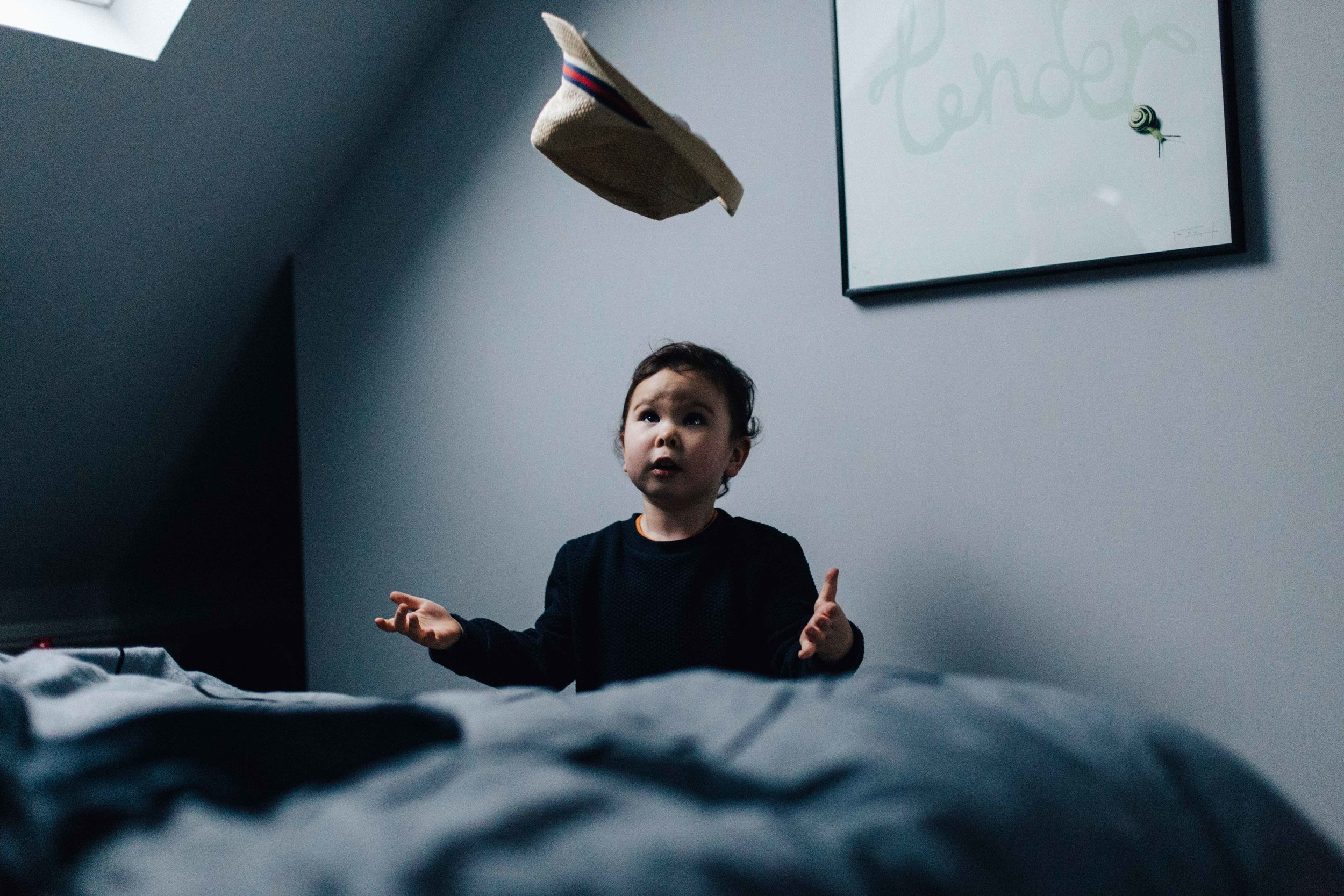 Boy throwing hat in the air