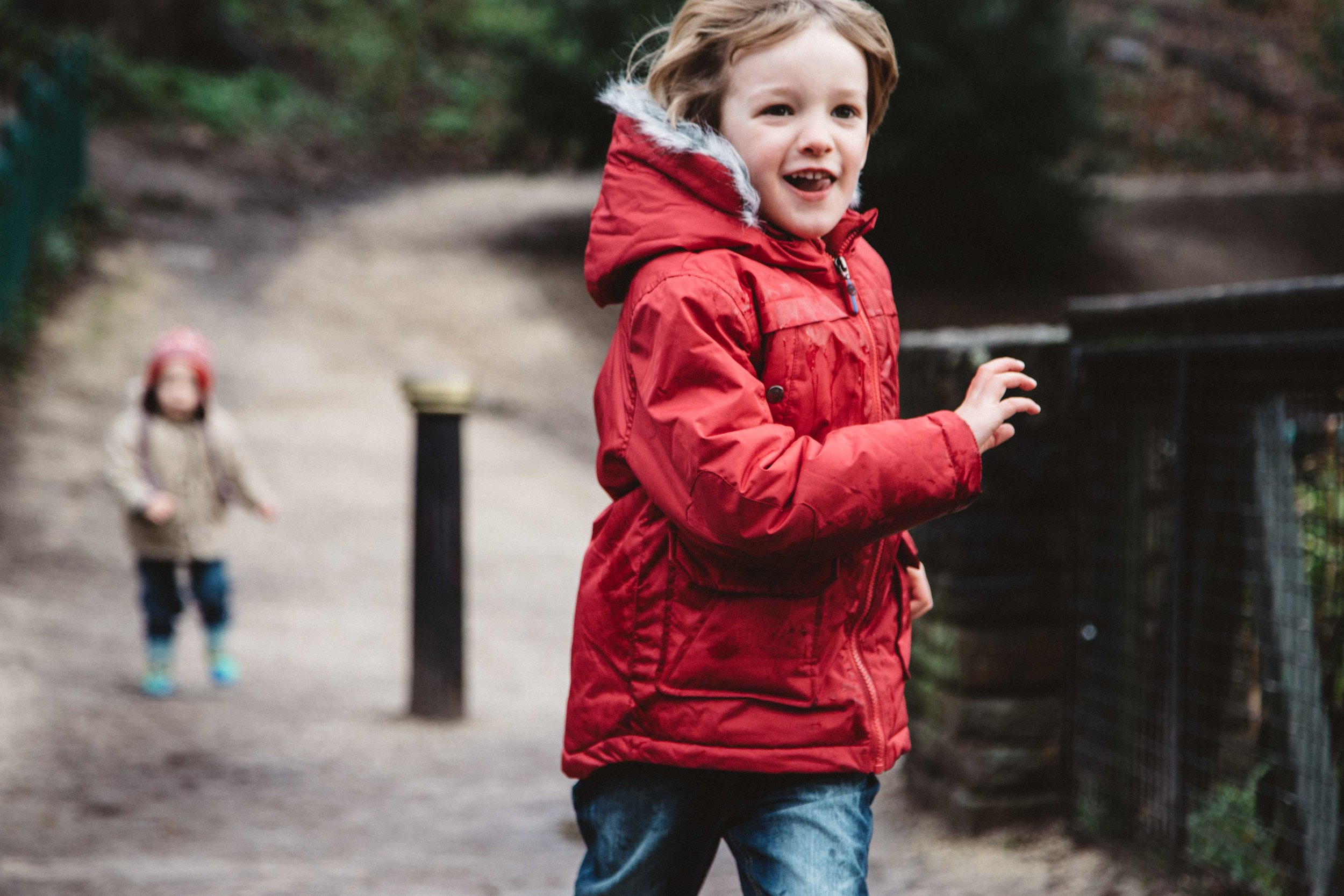 Boy running at Crystal Palace park during family photo session