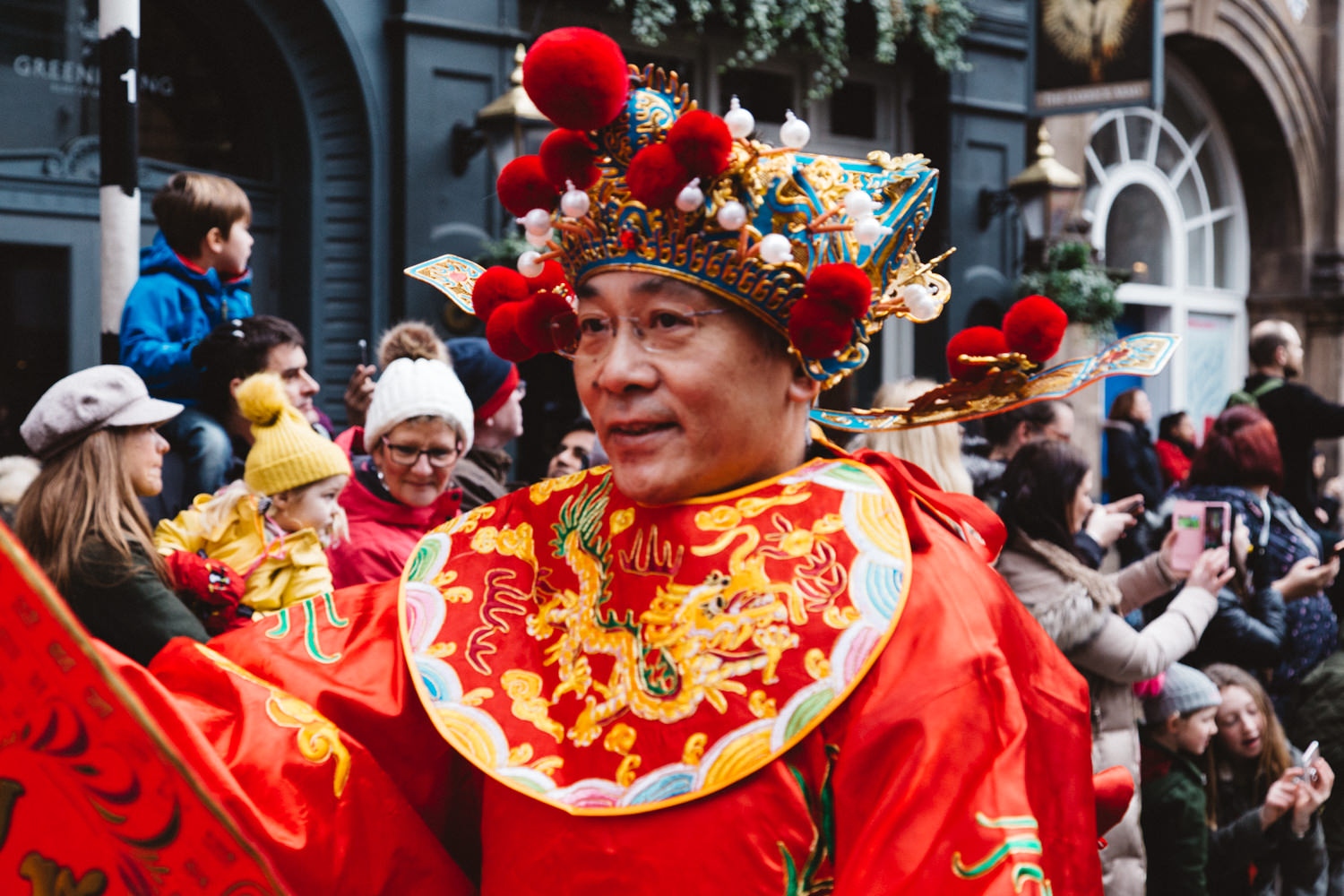 Man dressed in traditional Chinese outfit during the Chinese New Year Parade in London