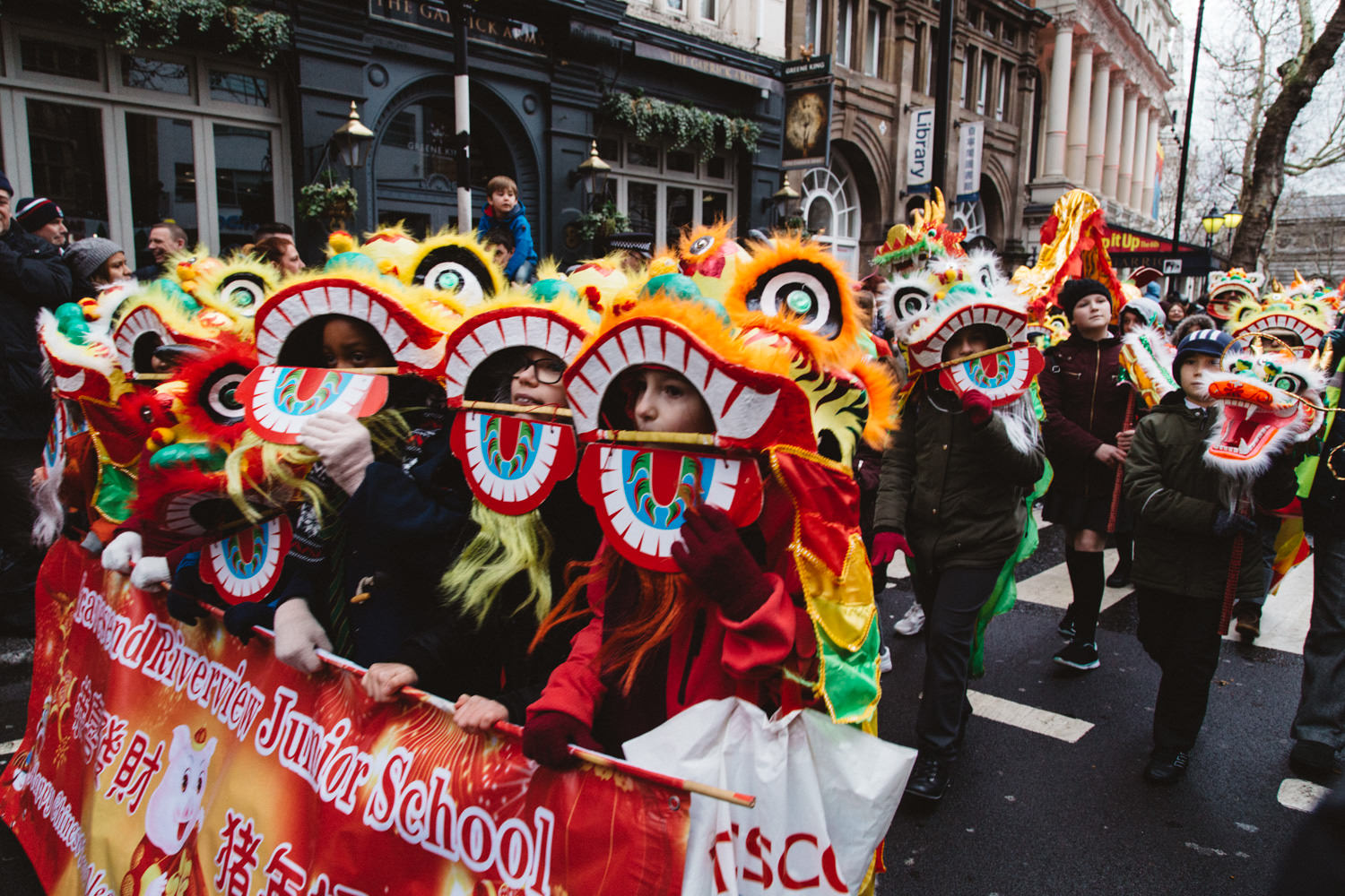 Children in lion's heads during the Chinese New Year Parade in London