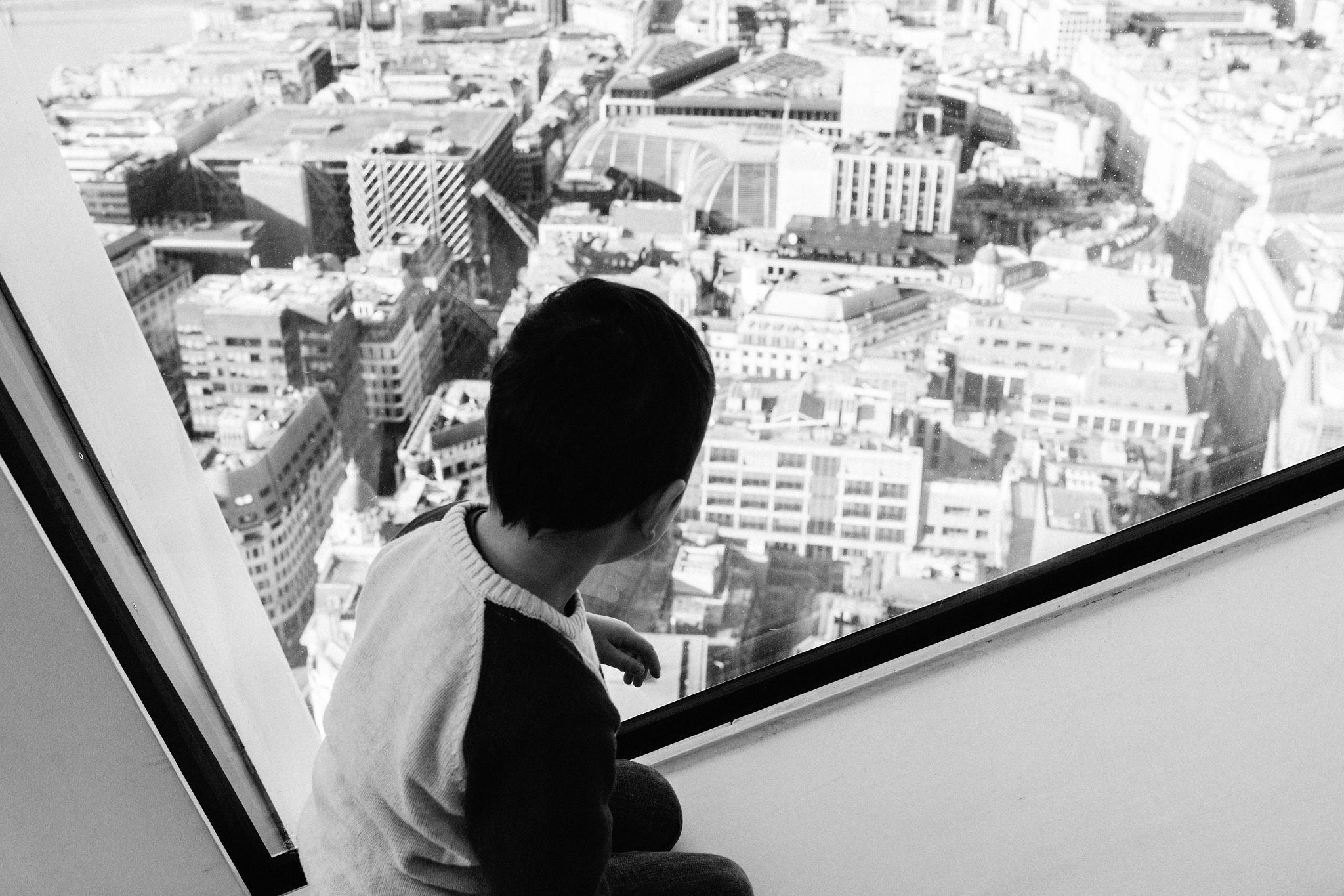 Child looking at London landscape from Skygarden