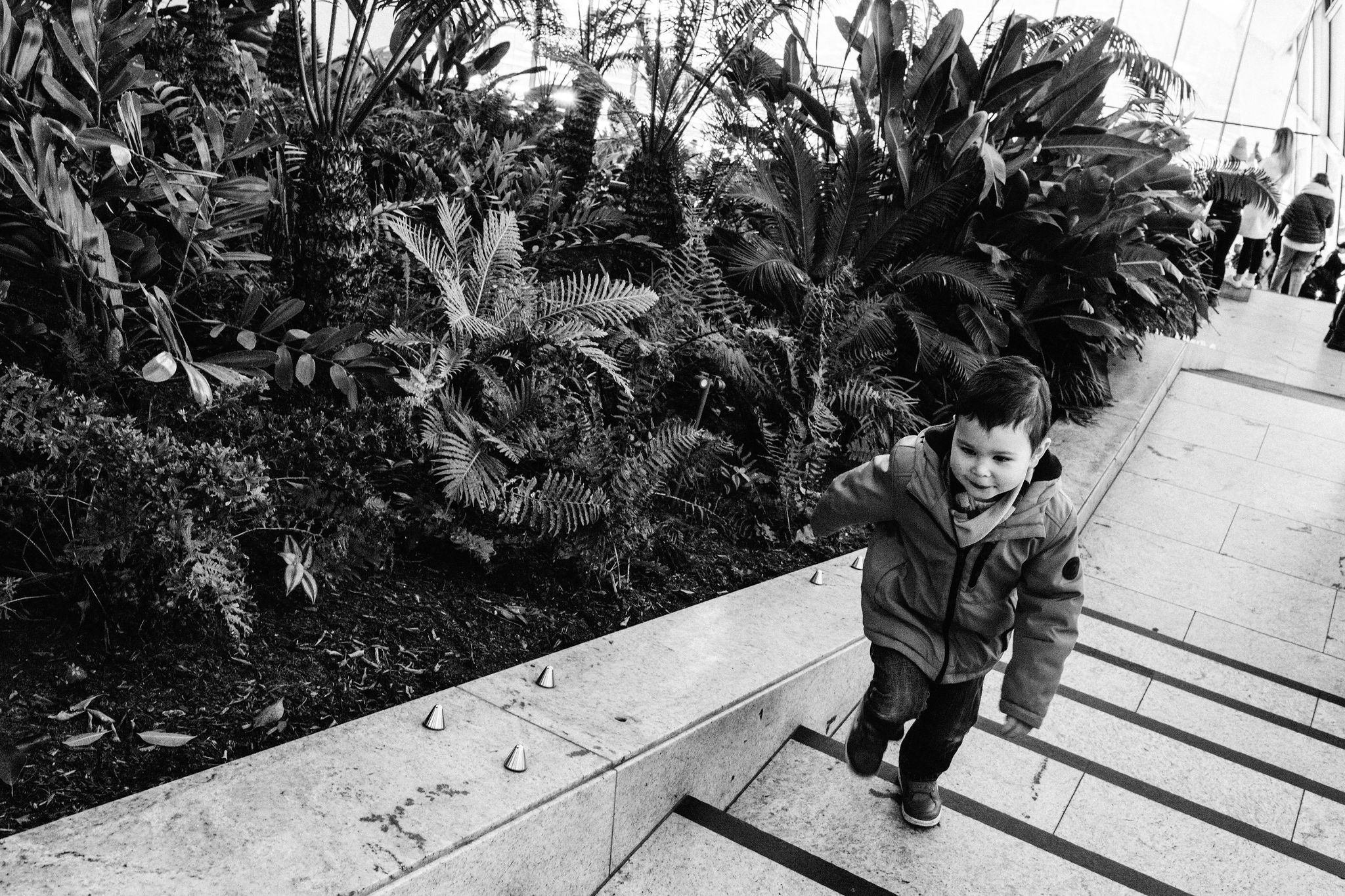 Child climbing up stairs at Skygarden during London photoshoot