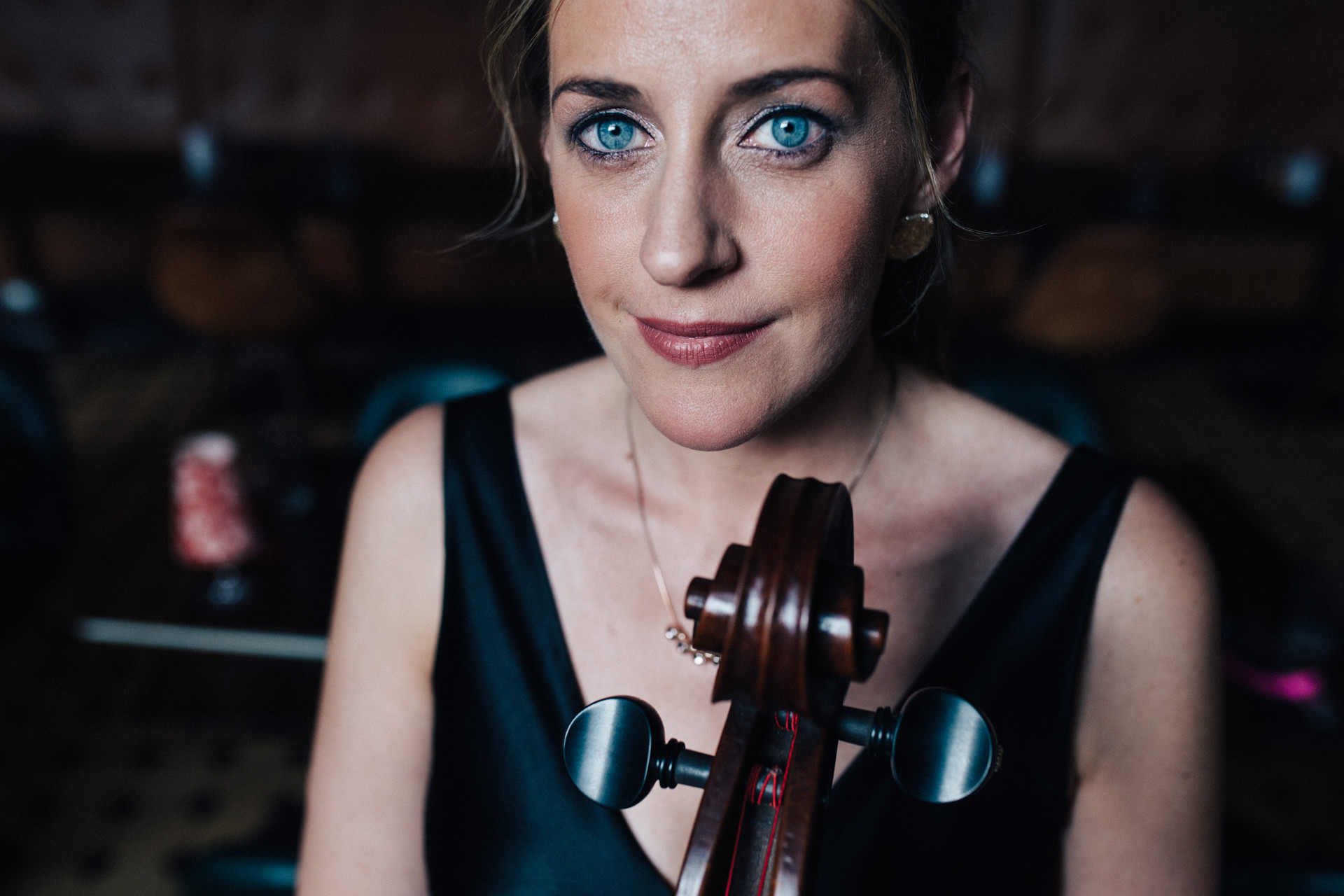 Close up portrait of cellist Katherine Jenkinson by Marion & You Photography