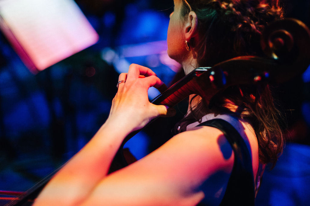 Details of cellist Katherine Jenkinson playing at the Royal Albert Hall