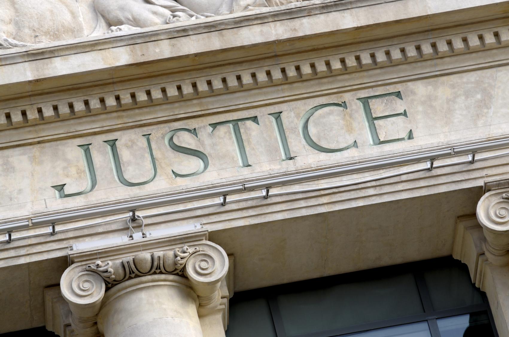 Fresno criminal defense attorney justice sign
