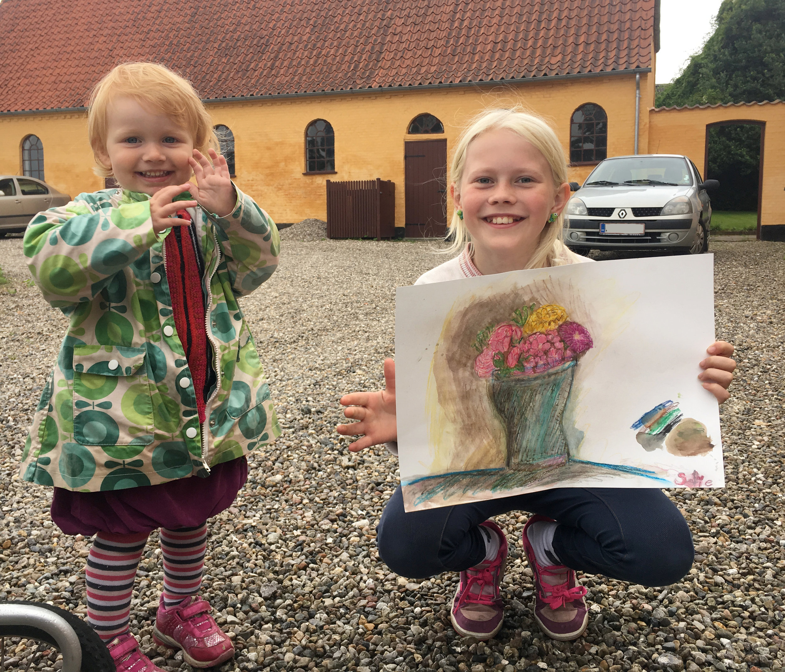 Sophie and her younger sister, Ina, pose with Sophie's gorgeous artwork. AND she gifted it to me! A treasure!