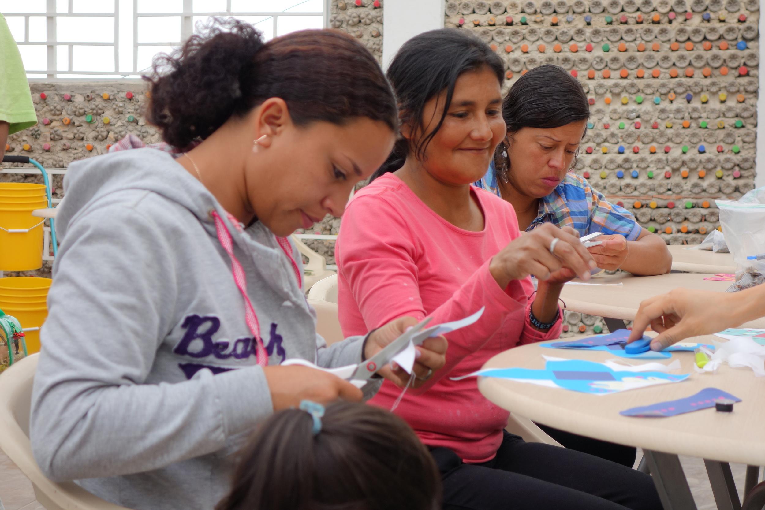Mireya, Noemi, and Lida learn to sew conejos